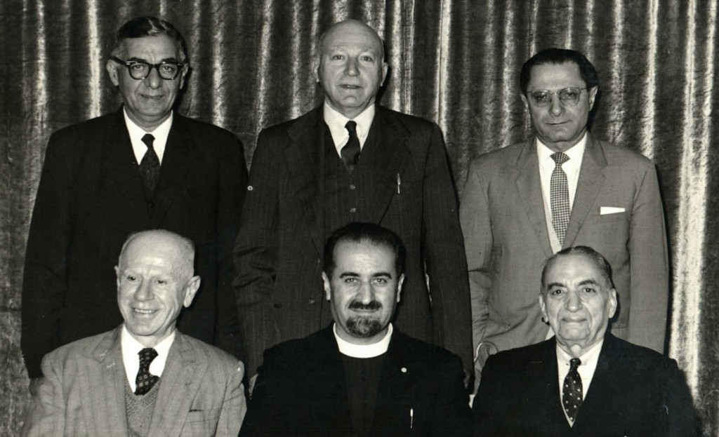 Vahan Hannesian [Secretary], Father Aramais Mirzayan, Mac Hagopian [Chairman] Standing left to right – Nahapet M. Nahapet, E.A. Edgar, Armen Apkar [Treasurer]