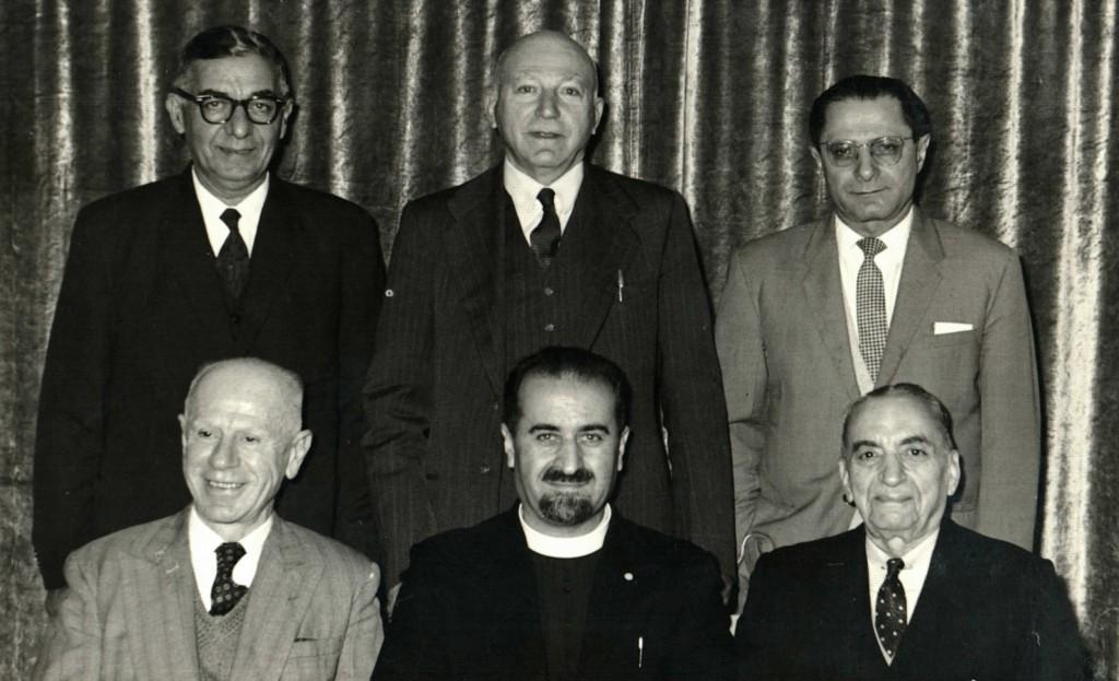 Vahan Hannesian [Secretary], Father Aramais Mirzayan, Mac Hagopian [Chairman] Standing left to right – Nahapet M. Nahapet, E.A. Edgar, Armen Apkar [Treasurer]